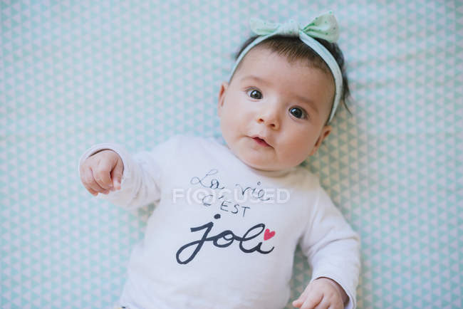 Baby girl with hair ribbon — Stock Photo