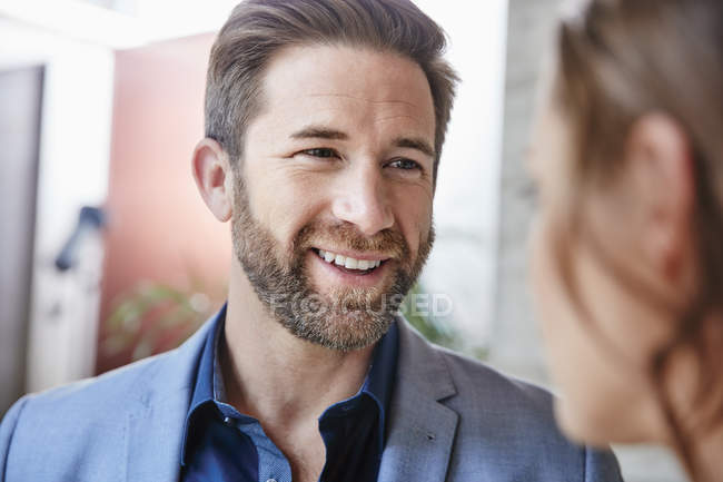 Businessman looking at businesswoman — Stock Photo