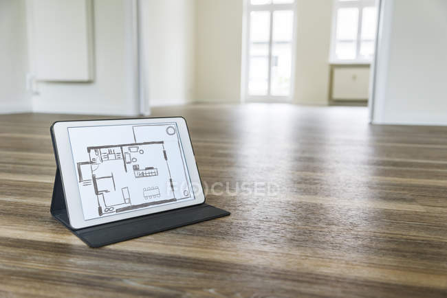 Tablet with floor plan — Stock Photo