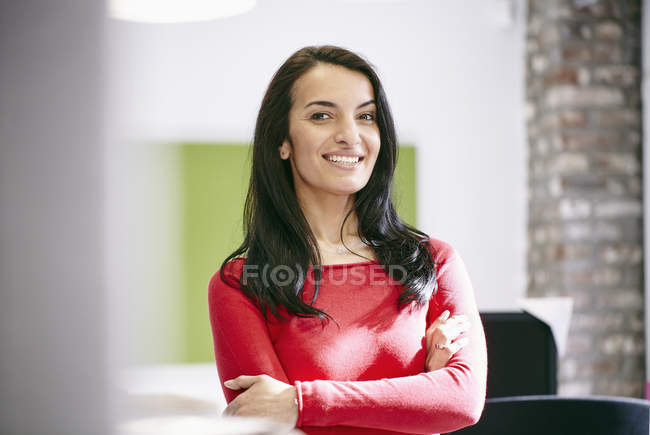 Businesswoman standing in modern office — Stock Photo