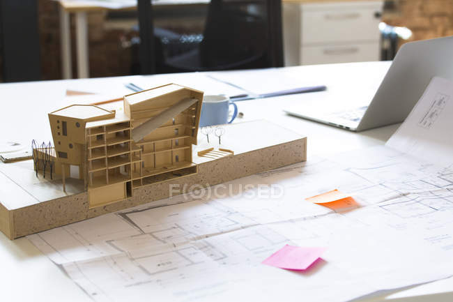 Desk with architectural model — Stock Photo