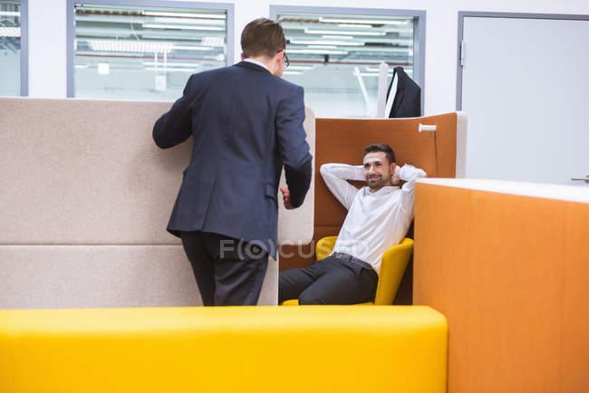 Businessmen talking in office — Stock Photo