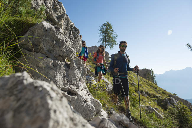 Friends trekking in mountains — Stock Photo