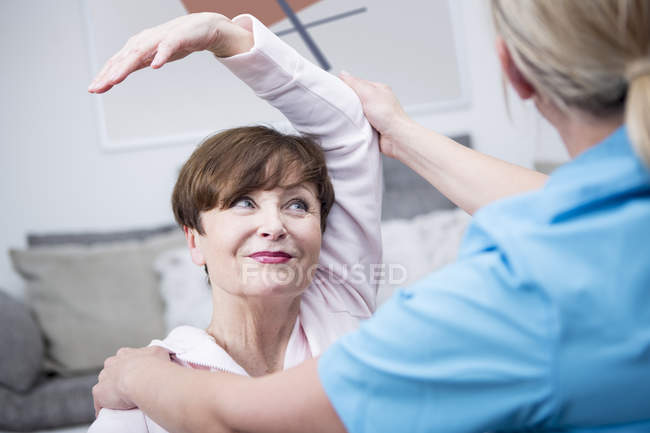 Nurse doing physio therapy with patient — Stock Photo