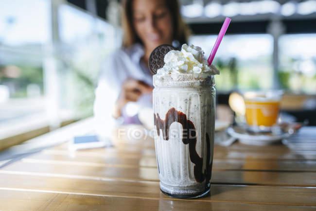 Glass of chocolate milkshake — Stock Photo