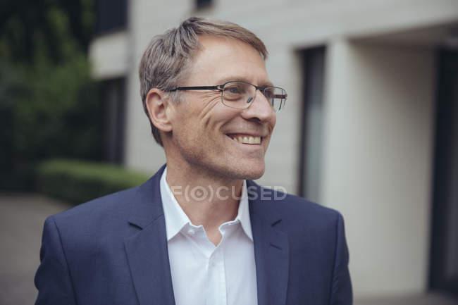 Sorridente maduro empresário — Fotografia de Stock