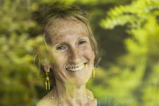 Portrait of happy senior woman with freckles — Stock Photo