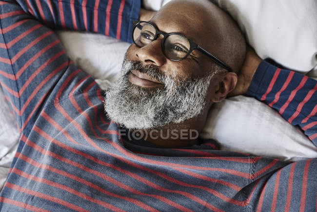 Man lying and smiling — Stock Photo