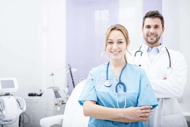 Portrait of two smiling doctors — Stock Photo
