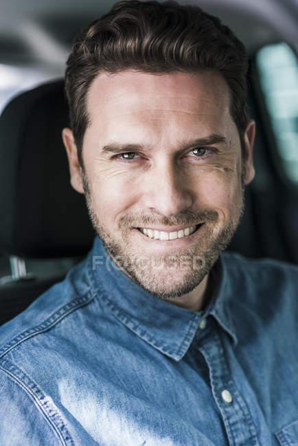 Businessman sitting in car — Stock Photo