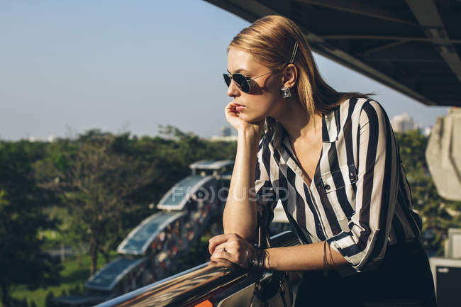 Stylish young woman enjoying sunlight — Stock Photo