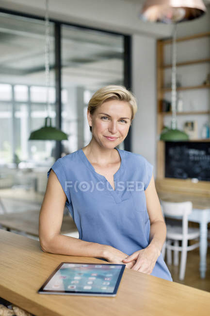 Blond woman with tablet — Stock Photo