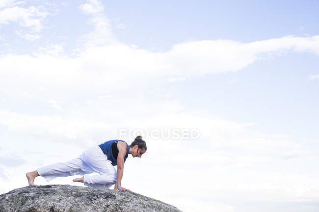 Woman doing yoga exercise — Stock Photo