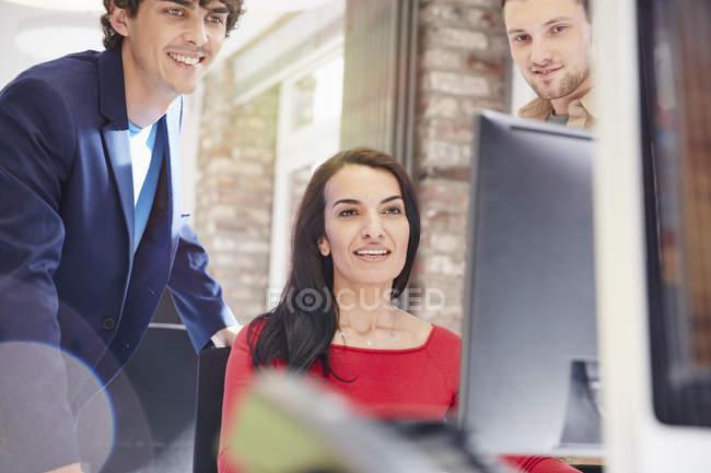 Creative team using computer — Stock Photo