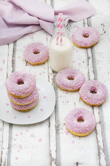 Doughnuts with pink icing and sugar granules — Stock Photo