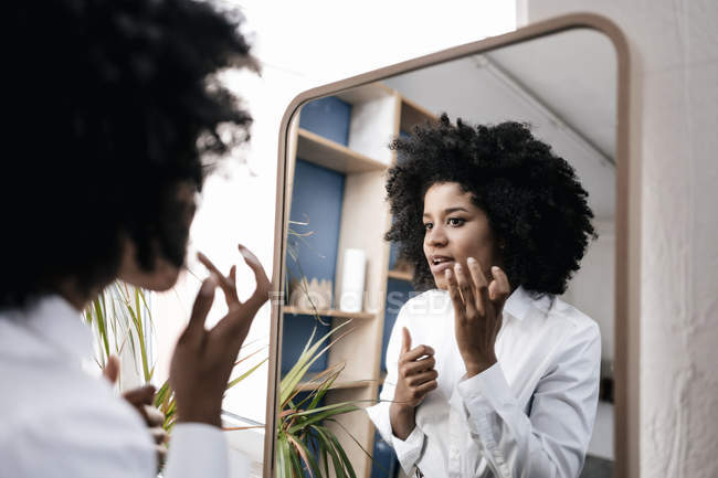 Woman applying lip care — Stock Photo