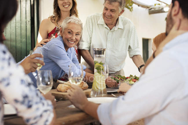 Family having lunch together outside — Stock Photo