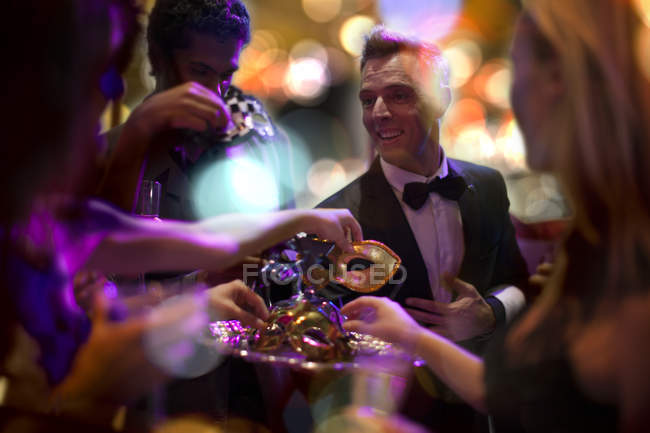 Man in tuxedo handing over on costume party — Stock Photo