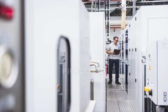 Man examining system — Stock Photo