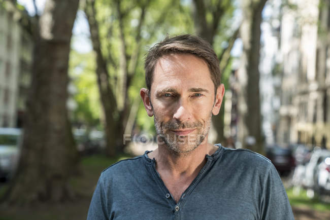 Man with stubble standing on street — Stock Photo