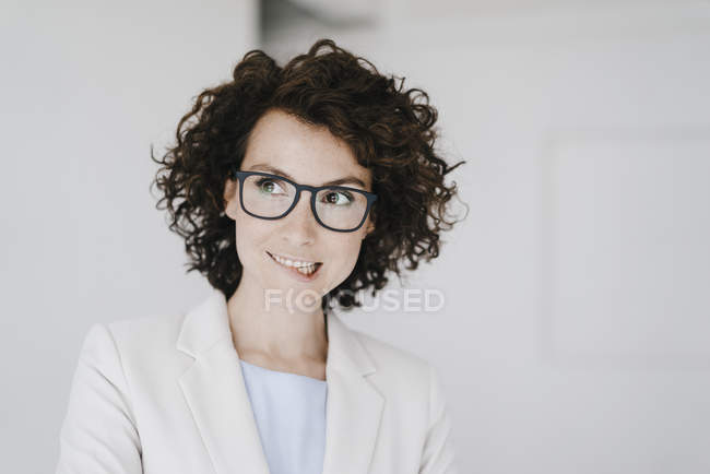 Businesswoman looking doubtfully — Stock Photo