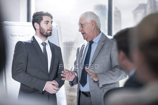 Businessmen talking in city office — Stock Photo