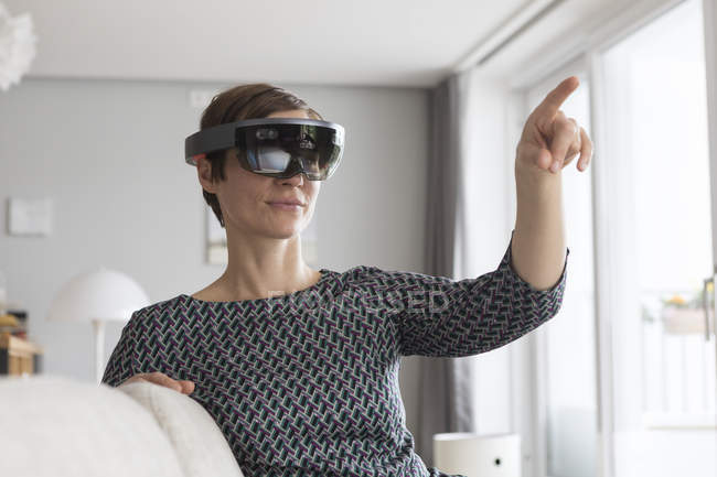 Woman using augmented reality glasses — Stock Photo