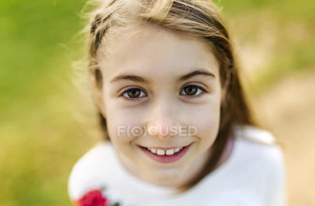 Girl looking at camera — Stock Photo