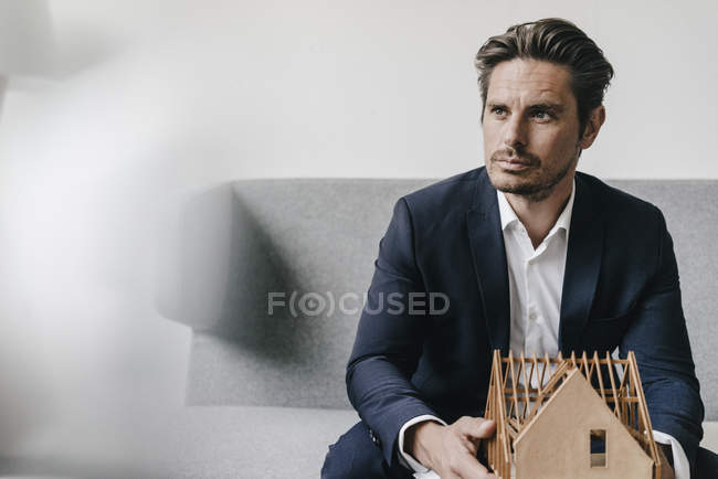 Architect holding architectural model — Stock Photo