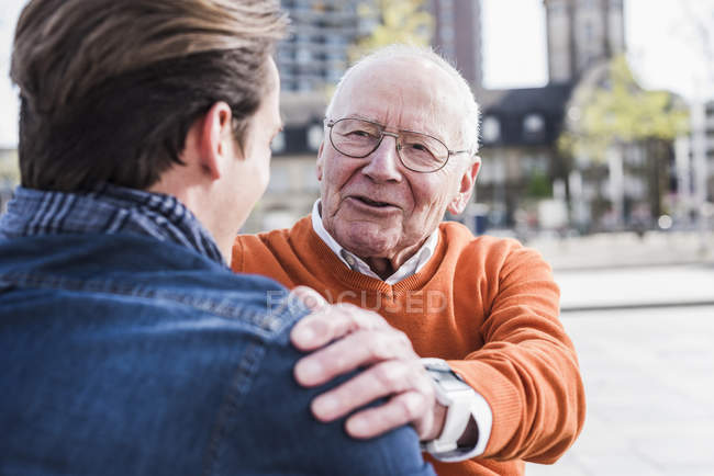 Senior man and grandson interacting — Stock Photo