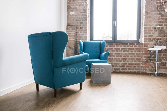 Arm chairs in lounge of office — Stock Photo