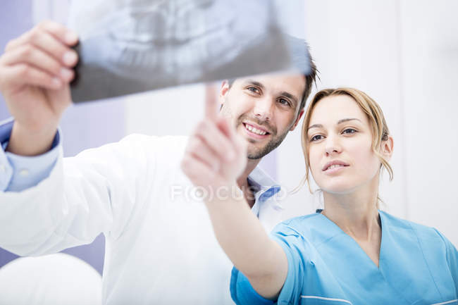 Doctors discussing dental x-ray — Stock Photo