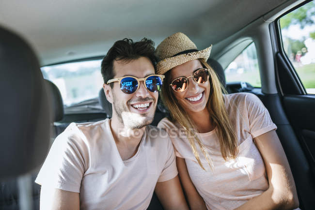 Couple in sunglasses laughing — Stock Photo