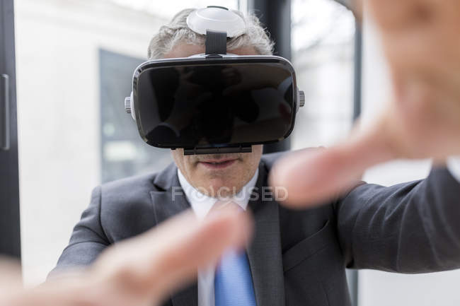 Businessman using VR goggles — Stock Photo