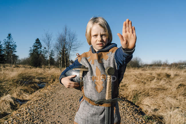 Boy wearing knight costume — Stock Photo