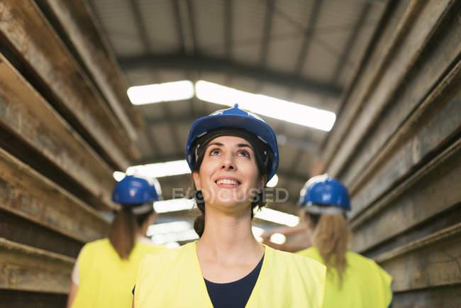 Female workers standing by steel girders — Stock Photo