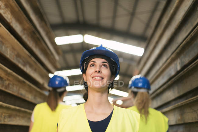 Female workers standing by steel girders — Stock Photo