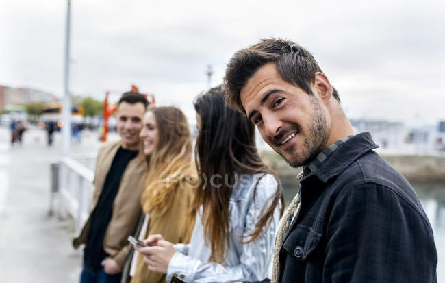 Group of friends walking in city — Stock Photo
