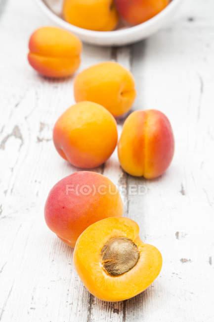 Fresh ripe apricots with half — Stock Photo