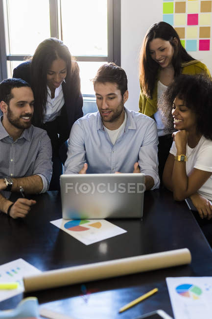 Business people sharing laptop — Stock Photo