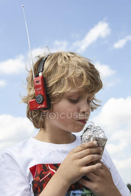 Portrait of boy drinking beverage dressed up as spaceman — Stock Photo