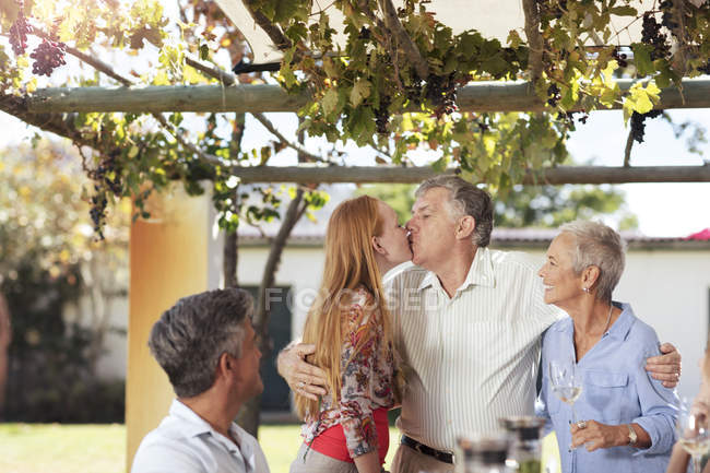 Senior couple with family having lunch — Stock Photo