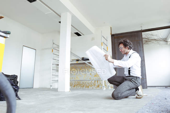 Architect with construction plan — Stock Photo