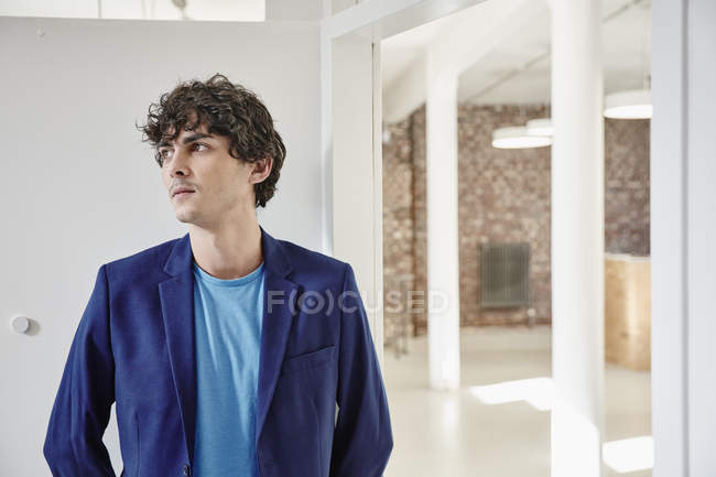 Man standing in modern office — Stock Photo
