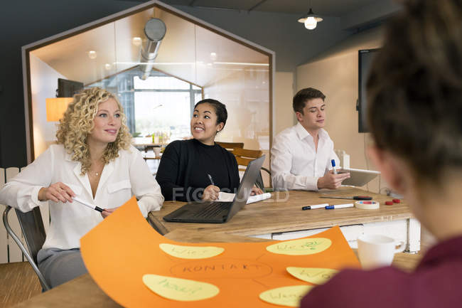Business people attending a workshop in the office — Stock Photo