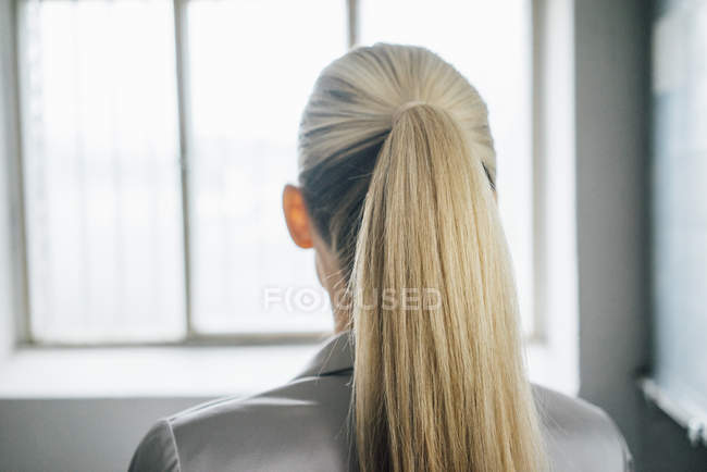 Blond woman with ponytail — Stock Photo