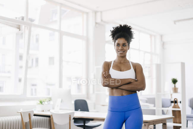 Woman standing in apartment — Stock Photo