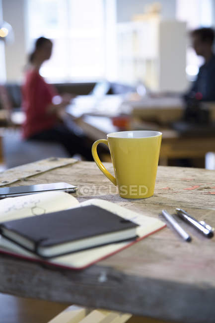 Notebook and coffee cup — Stock Photo