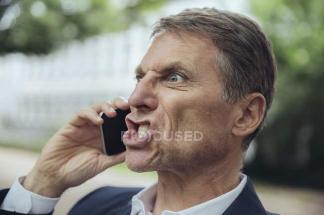 Angry mature businessman — Stock Photo