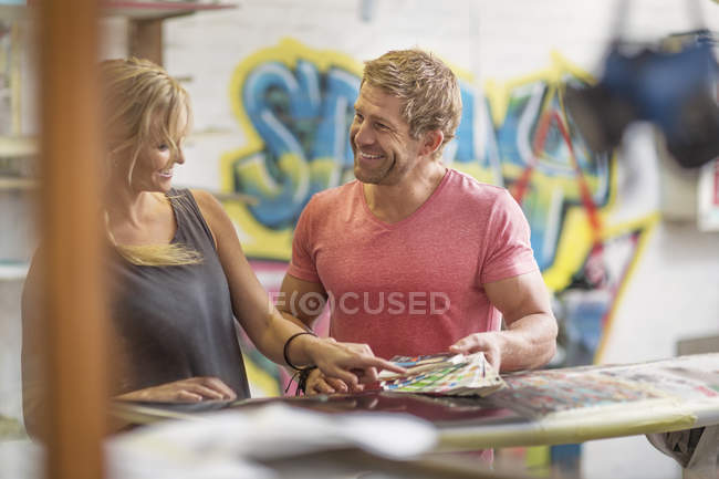 Man and woman selecting colours for design — Stock Photo